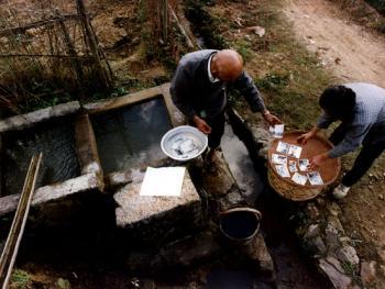 获世界基尼斯之最的山村摄影师李天炳