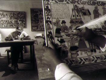 2.在利马的萨华艺术家画室中,画匠们用传统的画法在木板上绘画
