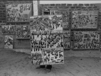 1.工作的胡安和他的作品,他身后就是古老的梁画