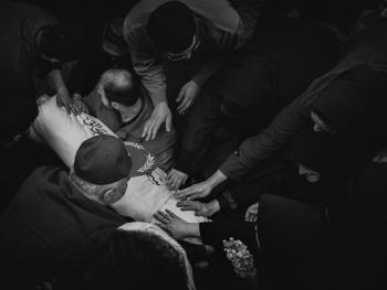 烈士哈撒贾尼归葬式13